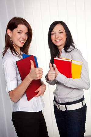 Two young women apprentices in conversation at school photo