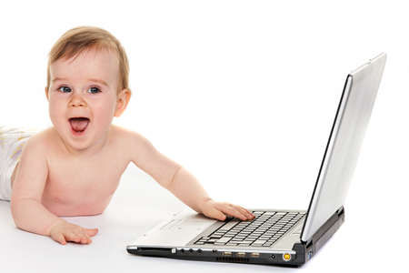 free dish: Small children in diapers playing with a laptop computer Stock Photo