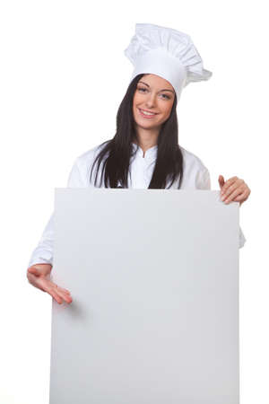 Young chef in training presents the day card Stock Photo