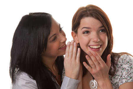 ms: Two young girls whisper the latest news about