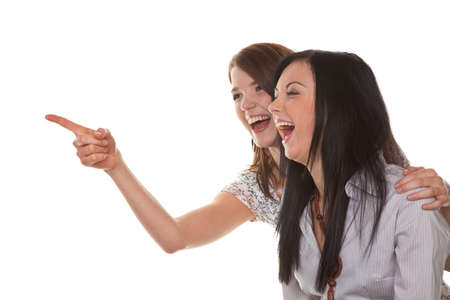 Two young girls to see something very funny and laugh Stock Photo - 4500692