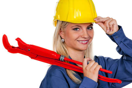 Portrait of a smiling young woman with a hardhat and pipe wrench. Horizontal. photo