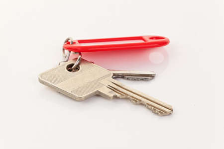 Close-up of two keys on a red key ring. Horizontal. photo