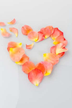 lovesickness: Broken heart with roses leaves. Symbol fpr Lovesickness