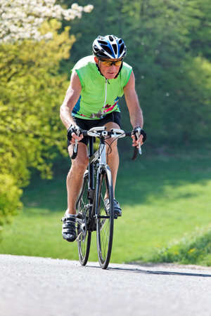 Active senior with bicycle for fitness photo