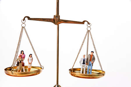Dolls on balancing scales. Horizontally framed shot. Stock Photo - 5945562