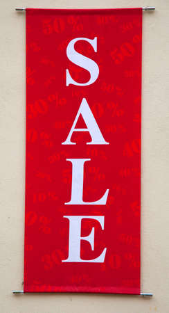 Close-up of red sale sign. Vertical. photo