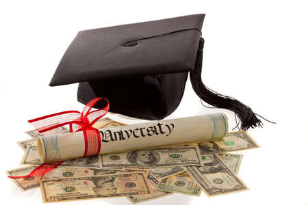 Still life of mortar board, diploma, and US currency. Symbol for education costs in America. Horizontal. photo