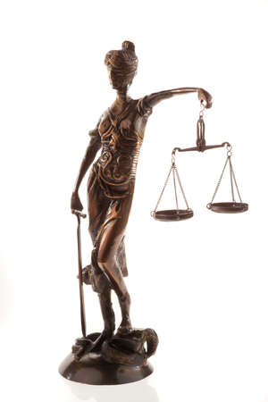 impartial: Sculpture of the scales of justice. Vertical.