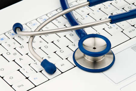 Stethoscope on laptop computer. Security for data on the Internet. Horizontal. Stock Photo - 5945325