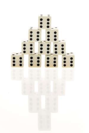 Pyramid of dice with sixes showing. Vertical. Stock Photo - 5945478