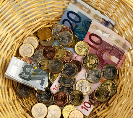 stash: Cash and coins in basket. Square format.