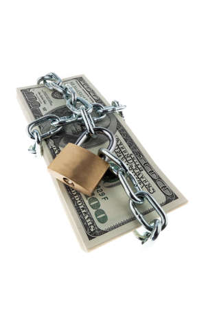 unreachable: American currency with chain and lock. Vertically framed shot. Stock Photo