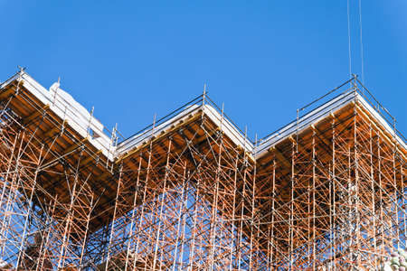 Concrete formwork and scaffolding on a construction site. Horizontally framed shot.  photo