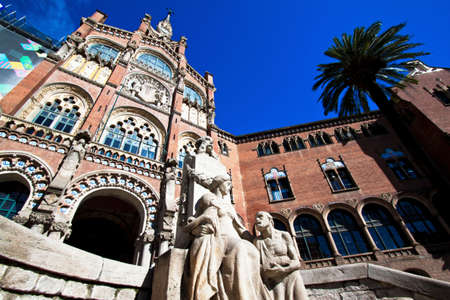 statuary: Hospital de Santa Creu of Gaudi, Barcelona, Catalonia, Spain, Europe.  Horizontally framed shot.