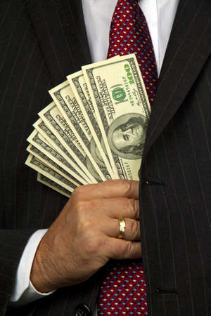 seem: Business man with many dollar bills. Ion of economic crime Stock Photo