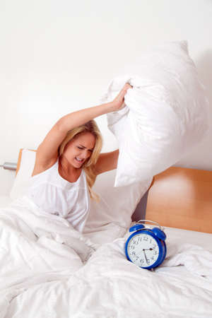 uyanmak: Young woman gets angry when you wake up and stand up. Alarm Clock (Clock rings).