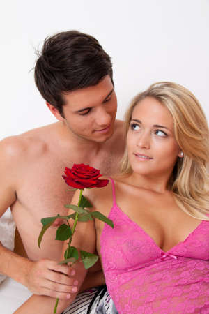 request: A romantic couple in bed with Rose. Marry the man. Stock Photo