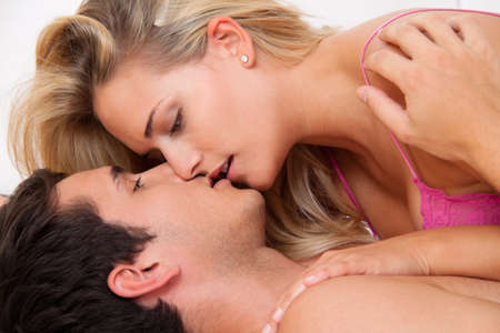 Couple in bed with sex and affection. Love and sex in the bedroom. Stock Photo - 7808439