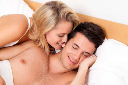 Couple has fun in bed. Laughter, joy and eroticism in the bedroom Stock Photo - 7808424