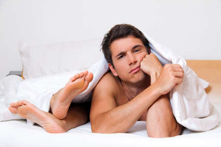frustrated man: A young couple in bed has problems and crisis. Divorce and separation. Stock Photo