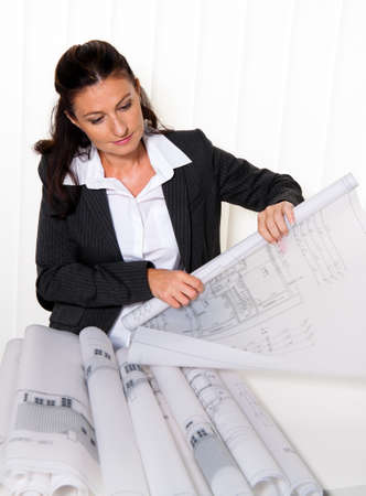 architect office: Architect with blueprint in the office. Squares ne a house will be processed Stock Photo