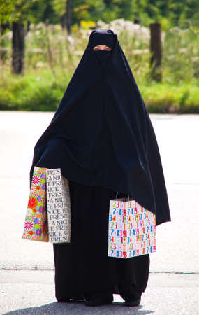 Example picture Islam. Muslim burqa is with obscured. photo