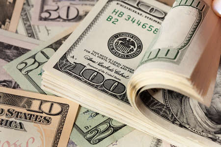 Image for photo wealth. Many American dollar bills photo