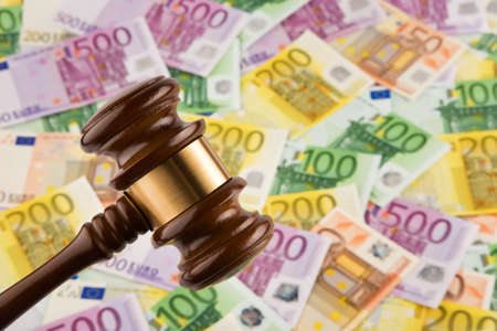 fees: . Euro notes and Gavel. Image for legal fees and auction