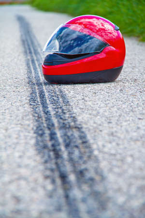 road rage: An accident with a motorcycle. Skid mark on road traffic accident. Icon photo.