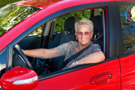 strapped: Older Woman when wearing a seat belt in a car.