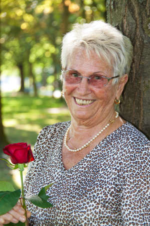 Happy older senior citizen with a red rose. Stock Photo - 7856887