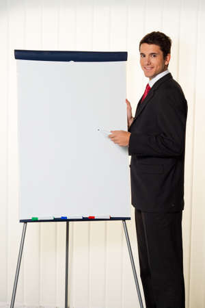 Successful businessman with a flip chart in a presentation photo