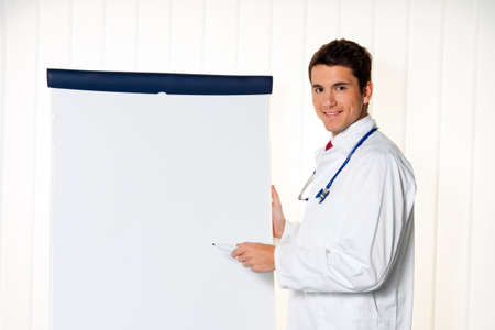 Successful businessman with a flip chart in a presentation in meeting photo
