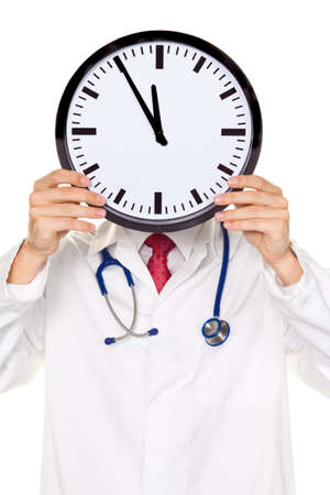 A doctor in trouble with Clock in front of the head. Working in Kranklenhaus. photo