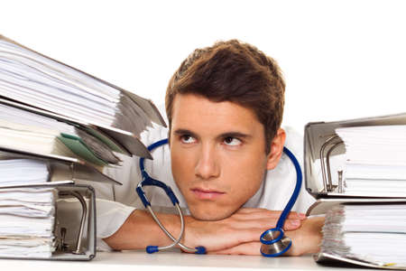 paperless: A doctor in trouble with stacks of files. Bureaucracy in the hospital.