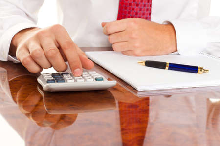 costs: Businessman with a calculator. Calculation of costs, revenues, balance sheet