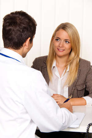 screening: Doctors call. Patient and doctor talking to a doctors office