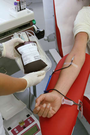 Woman at the blood donation in a blood laboratory photo
