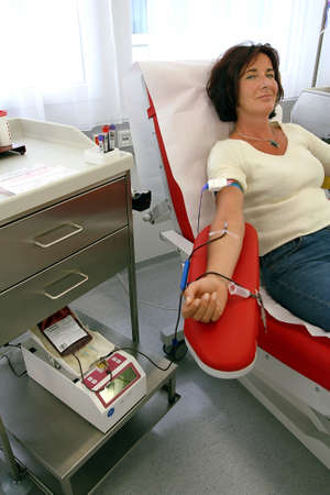 blood test: Woman at the blood donation in a blood laboratory