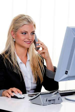 Young woman in a telephone call in the office. photo