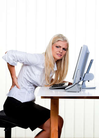 Young woman with pain in the back office. Stock Photo - 7939615