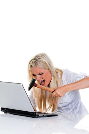 Woman with computer problems, hammer and Laptop: photo