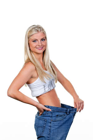 Young woman after a successful diet with great pants: Stock Photo - 7939698