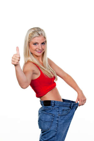 Young woman after a successful diet with great pants: photo