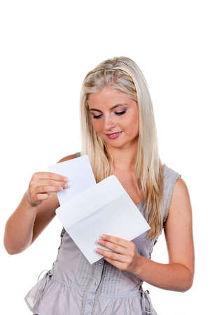 art processing: Young woman is a letter in an envelope.