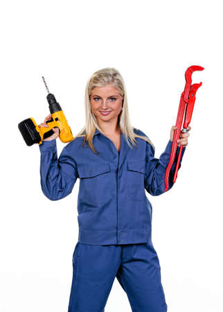 apprenticeships: Young woman in blue work clothes with a drill