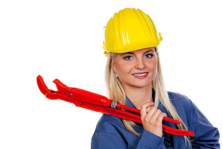 apprenticeships: Young woman in blue work clothes with a pipe wrench.