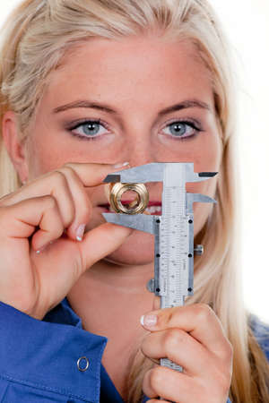 Young woman as plumbing in blue work clothes. photo