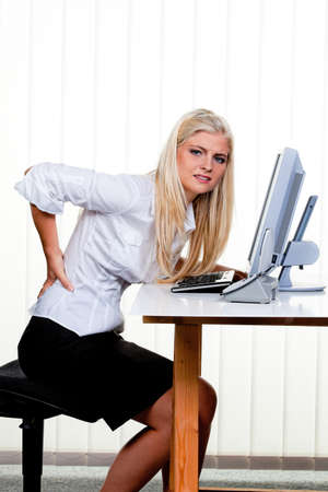 Young woman with pain in the back office. Stock Photo - 7939657